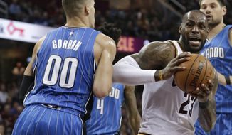 Cleveland Cavaliers' LeBron James (23) drives around Orlando Magic's Aaron Gordon (00) in the first half of an NBA basketball game, Tuesday, April 4, 2017, in Cleveland. (AP Photo/Tony Dejak)