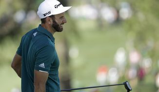 Dustin Johnson smiles on the seventh green during a practice round for the Masters golf tournament Tuesday, April 4, 2017, in Augusta, Ga. (AP Photo/Matt Slocum)