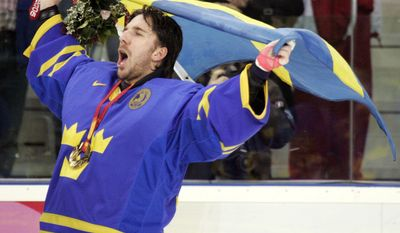FILE - In this Sunday, Feb. 26, 2006, file photo, Sweden's goalie Henrik Lundqvist celebrates after beating Finland 3-2 to win the gold medal in the 2006 Winter Olympics men's ice hockey gold medal game in Turin, Italy. One of the greatest performance of Lundqvist's illustrious career came in 2006 when he led Sweden to the gold medal by making 25 saves in an epic final against archrival Finland. (AP Photo/Gene J. Puskar, File)
