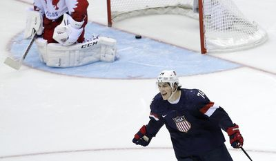FILE - In this Feb. 15, 2014, file photo, USA forward T.J. Oshie reacts after scoring the winning goal against Russia goaltender Sergei Bobrovski in a shootout during overtime of a men's ice hockey game at the 2014 Winter Olympics in Sochi, Russia. A back-and-forth game between the U.S. and host Russia in Sochi played at a breakneck pace went to a shootout with Vladimir Putin watching from inside Bolshoy Ice Dome. U.S. coach Dan Bylsma could've picked different shooters but went back to Oshie over and over and was rewarded as the winger scored on four of his six shootout attempts to give the Americans a memorable victory. (AP Photo/David J. Phillip, File)