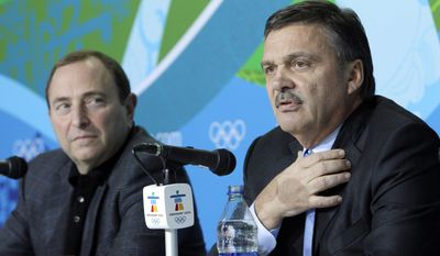 """FILE - In this Feb. 18, 2010, file photo, Rene Fasel, International Ice Hockey Federation President, right, and Gary Bettman, National Hockey League Commissioner,  are seen during a press conference at the Vancouver 2010 Olympics in Vancouver, British Columbia. NHL Players are raising doubts about the finality of the NHL announcement that it won't participate in the 2018 Olympics. IIHF president Fasel called the NHL's decision one that robs fans of a best-on-best competition, saying """"at the end of the day, ice hockey loses here.""""  (AP Photo/Gerry Broome, File)"""