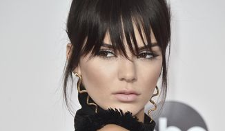 In this Nov. 22, 2015, file photo, Kendall Jenner arrives at the American Music Awards in Los Angeles. (Photo by Jordan Strauss/Invision/AP, File)