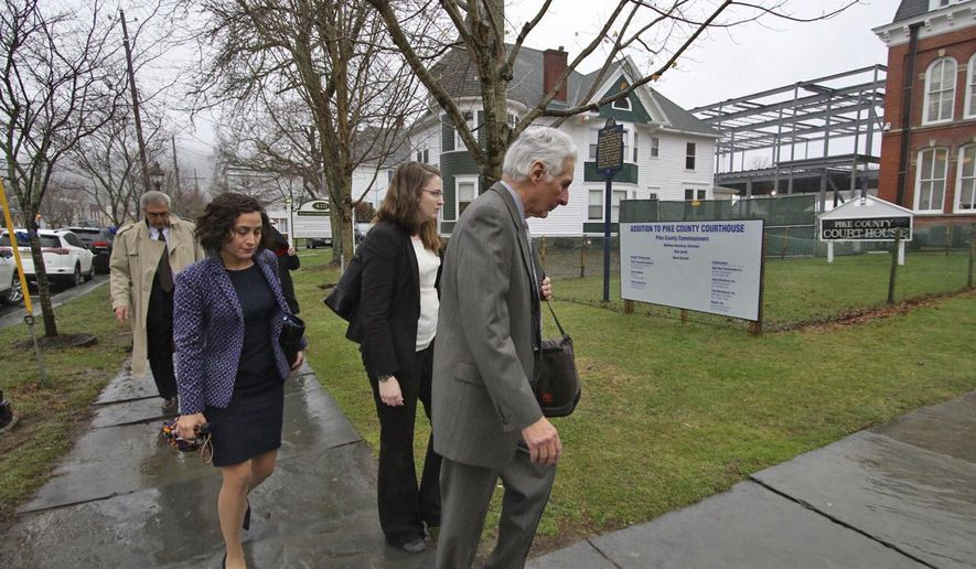 The legal defense team for Eric Frein, an anti-government survivalist accused of killing a Pennsylvania police trooper and injuring a second in a 2014 ambush at their barracks, arrive for the first day of Frein's trial Tuesday, April 4, 2017, at the Pike County Courthouse in Milford, Pa. Frein could face a death sentence if convicted in the sneak attack in northeastern Pennsylvania that killed Cpl. Bryon Dickson II, critically wounded Trooper Alex Douglass and led to a 48-day manhunt in the Pocono Mountains before U.S. marshals captured Frein. (Mike Mullen/The Times-Tribune via AP)