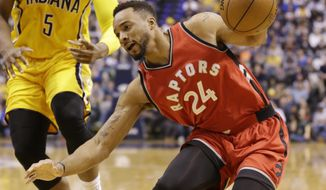 Toronto Raptors guard Norman Powell (24) changes direction as he drives in front of Indiana Pacers forward Lavoy Allen (5) during the first half of an NBA basketball game in Indianapolis, Tuesday, April 4, 2017. (AP Photo/Michael Conroy)