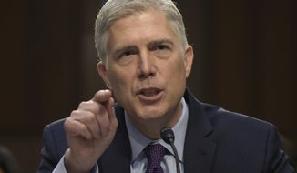 In this March 21, 2017, file photo, Supreme Court Justice nominee Neil Gorsuch testifies on Capitol Hill in Washington during his confirmation hearing before the Senate Judiciary Committee. A divided Senate Judiciary Committee backed Gorsuch, Monday, April 3, 2017. GOP likely to change Senate rules to confirm him. (AP Photo/Susan Walsh, File)