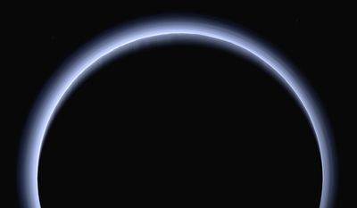 This image made available by NASA in March 2017 shows Pluto illuminated from behind by the sun as the New Horizons spacecraft travels away from it at a distance of about 120,000 miles (200,000 kilometers). On Friday, April 7, 2017, the spacecraft will reach a halfway between Pluto and its next much, much smaller stop, the Kuiper Belt object 2014 MU69. (NASA/Johns Hopkins University Applied Physics Laboratory/Southwest Research Institute via AP)