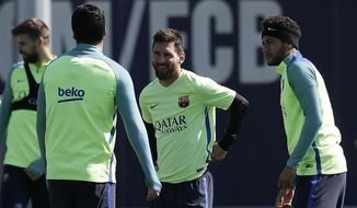 FC Barcelona's Neymar, right, Lionel Messi, center, and Luis Suarez, back, attend a training session at the Sports Center FC Barcelona Joan Gamper in Sant Joan Despi, Spain, Tuesday, April 4, 2017. FC Barcelona will play against Sevilla during a Spanish La Liga on Wednesday. (AP Photo/Manu Fernandez)