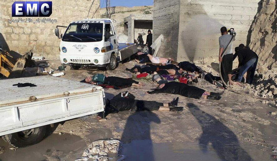 This photo provided Tuesday, April 4, 2017 by the Syrian anti-government activist group Edlib Media Center, which has been authenticated based on its contents and other AP reporting, shows  victims of a suspected chemical attack, in the town of Khan Sheikhoun, northern Idlib province, Syria. The suspected chemical attack killed dozens of people on Tuesday, Syrian opposition activists said, describing the attack as among the worst in the country's six-year civil war. (Edlib Media Center, via AP)