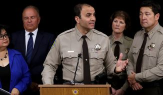 Maricopa County Sheriff Paul Penzone announces that he's shutting down a complex of jail tents Tuesday, April 4, 2017, in Phoenix. Penzone announced that he will be closing the tent city jail in the coming months and relocating inmates to other jails. (AP Photo/Matt York)