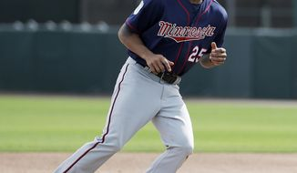 FILE - In this Feb. 21, 2017, file photo, Minnesota Twins' Byron Buxton runs on the field during a spring training baseball workout in Fort Myers, Fla. Buxton's first major league stints weren't so smooth, but the Twins have full faith in their former No. 2 overall draft pick. Despite going 0 for 5 with three strikeouts in the season opener Monday, April 3, in the No. 3 spot in the lineup, Buxton made two diving catches of sinking line drives in center field. (AP Photo/David Goldman, File)