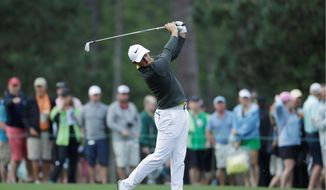 Rory McIlroy hits from the 15th fairway during a practice round for the Masters on Wednesday in Augusta, Georgia. McIlroy needs just a Masters win for the career Grand Slam. (Associated Press)