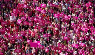 Demonstrators participate in a rally for Planned Parenthood at the Capitol in Austin, Texas, on Wednesday, April 5, 2017. (Jay Janner/Austin American-Statesman via AP)