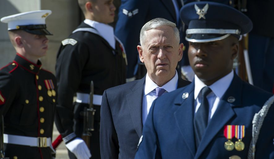 Defense Secretary Jim Mattis waits for the arrival of Singapore's Defense Minister Ng Eng Hen to the Pentagon, Wednesday, April 5, 2017. (AP Photo/Cliff Owen)