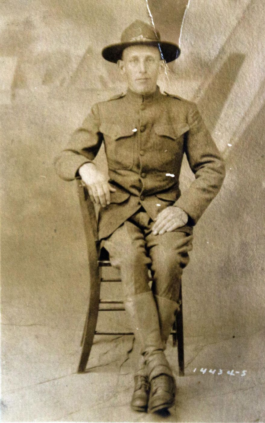 In this undated image provided by the family of Mary Thompson, Army Private Guy Ford poses for an official American Expeditionary Force photo. Guy Ford, from a small town in West Virginia was drafted into the Army and sent to France to fight in the Meuse-Argonne during World War I. (Mary Thompson via AP)
