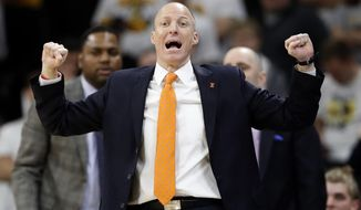 FILE - In this Feb. 18, 2017, file photo, then-Illinois head coach John Groce directs his team during the second half of an NCAA college basketball game against Iowa, in Iowa City, Iowa. Akron has hired former Illinois coach John Groce to take over its program.Groce replaces Keith Dambrot, who surprisingly left his alma mater last week after a successful run to coach at Duquesne. (AP Photo/Charlie Neibergall, File)