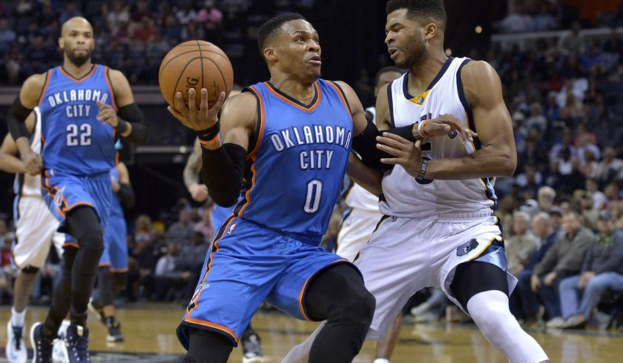 Oklahoma City Thunder guard Russell Westbrook (0) drives against Memphis Grizzlies guard Andrew Harrison, right, during the first half of an NBA basketball game Wednesday, April 5, 2017, in Memphis, Tenn. (AP Photo/Brandon Dill)