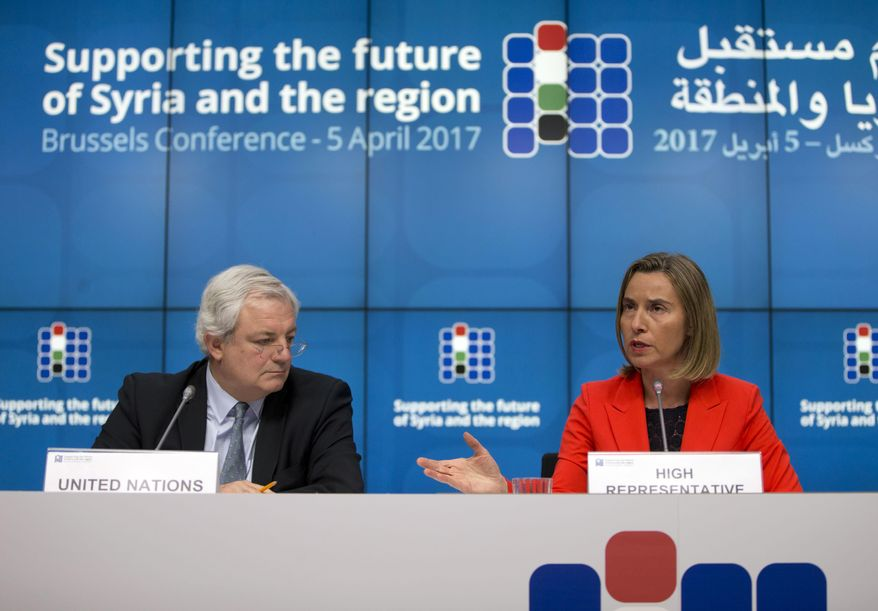 European Union High Representative Federica Mogherini, right, and UN Office for the Coordination of Humanitarian Affairs Greg O'Brien, left, address a media conference at an EU Syria conference at the Europa building in Brussels on Wednesday, April 5, 2017. The EU and other nations met Wednesday to discuss what will be needed to rebuild war-ravaged Syria. (AP Photo/Virginia Mayo)