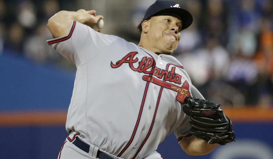 Atlanta Braves starting pitcher Bartolo Colon delivers a pitch during the first inning of a baseball game against the New York Mets, Wednesday, April 5, 2017, in New York. (AP Photo/Frank Franklin II)