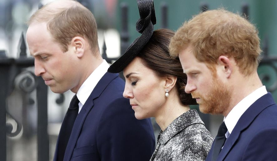 """From left, Britain's Prince William, Kate the Duchess of Cambridge and Prince Harry stand together after William laid a wreath after arriving for a """"Service of Hope"""" at Westminster Abbey, two weeks after the March 22 London terror attack, in London, Wednesday, April 5, 2017. The service took place near Westminster Bridge, where Khalid Masood mowed down pedestrians before stabbing a police officer outside Parliament. (AP Photo/Matt Dunham)"""