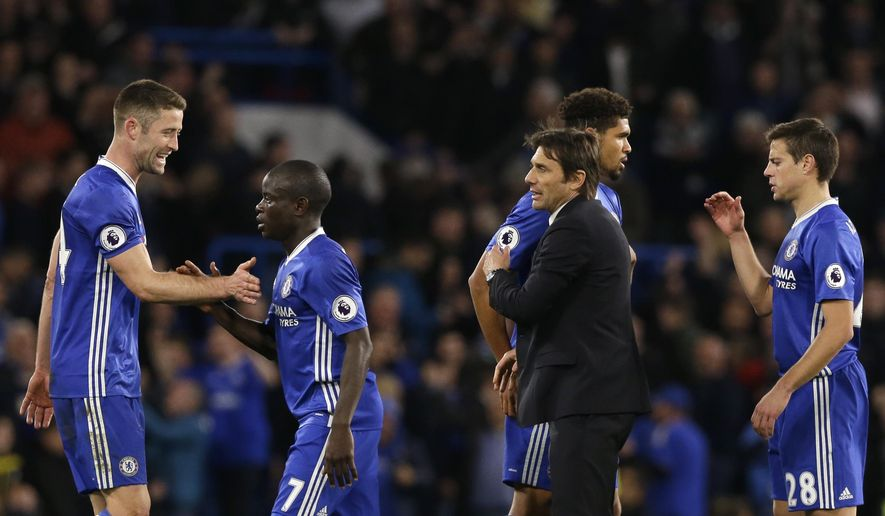 Chelsea's Gary Cahill, N'Golo Kante and team manager Antonio Conte, from left, celebrate at the end of the English Premier League soccer match between Chelsea and Manchester City at the Stamford Bridge stadium in London, Wednesday, April 5, 2017. Chelsea won 2-1. (AP Photo/Alastair Grant)