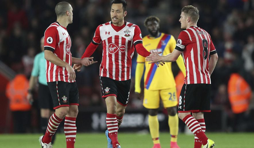 Southampton's Maya Yoshida, centre, celebrates scoring his side's second goal of the game against Crystal Palace during their English Premier League soccer match at St Mary's Stadium in Southampton, England, Wednesday April 5, 2017. (Andrew Matthews/PA via AP)