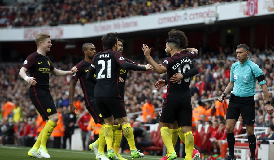 Manchester City's players celebrate after Leroy Sane scored the opening goal during the English Premier League soccer match between Arsenal and Manchester City at the Emirates stadium in London, Sunday, April 2, 2017. (AP Photo/Alastair Grant)