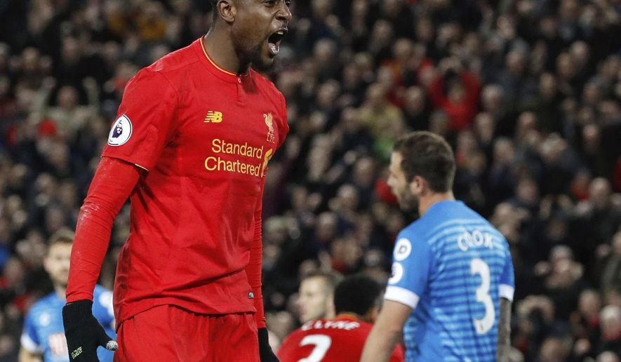 Liverpool's Divock Origi celebrates scoring his side's second goal of the game during the English Premier League soccer match, Liverpool against AFC Bournemouth at Anfield, Liverpool, England, Wednesday April 5, 2017. (Martin Rickett/PA via AP)