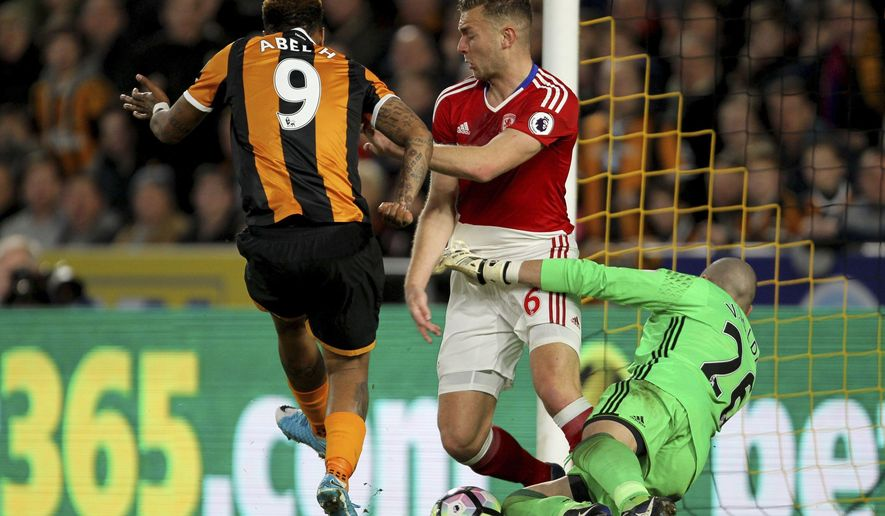 Hull City's Abel Hernandez, left, and Middlesbrough's Ben Gibson react in the goal mouth in an unsuccessful attempt on goal during the English Premier League soccer match at the KCOM Stadium in Hull, England, Wednesday April 5, 2017. (Richard Sellers/PA via AP)