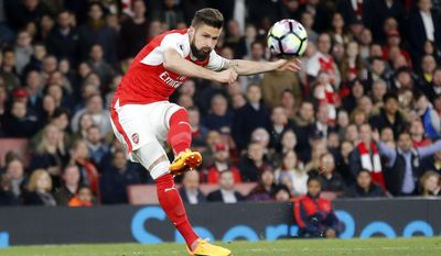 Arsenal's Olivier Giroud shoots to score during the English Premier League soccer match between Arsenal and West Ham at the Emirates stadium in London, Wednesday, April 5, 2017.(AP Photo/Frank Augstein)