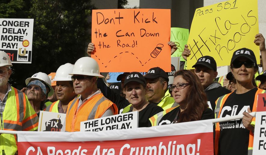 Supporters of a plan for a $5 billion-a-year tax and fee road repair measure rally at the Capitol, Wednesday, April 5, 2017, in Sacramento, Calif. The bill, SB1, supported by Calif., Gov. Jerry Brown and Democratic Legislative leaders, is expected to be voted on by the California Legislature on Thursday. (AP Photo/Rich Pedroncelli)