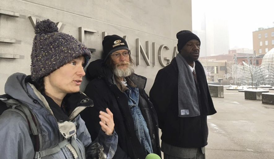 In this Tuesday morning, April 5, 2017 photo, from left, Therese Howard, Randy Russell and Jerry Burton speak to reporters before heading into a courtroom in Denver, to stand trial for allegedly violating the city's camping ban. The three defendants are trying to turn the tables on the city by drawing attention to what they think is an immoral law that makes it dangerous for homeless people trying to survive on the street. (AP Photo/Colleen Slevin)