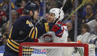 Buffalo Sabres defenseman Justin Falk (41) and Montreal Canadiens forward Andrew Shaw (65) get the sticks up during the second period of an NHL hockey game, Wednesday, April 5, 2017, in Buffalo, N.Y. (AP Photo/Jeffrey T. Barnes)