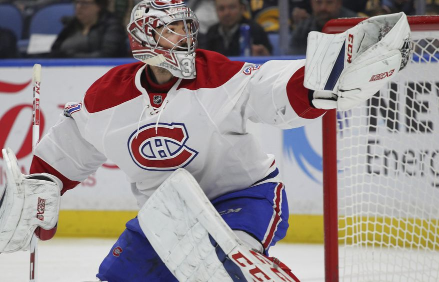 Montreal Canadiens goalie Carey Price (31) makes a glove save during the first period of an NHL hockey game against the Buffalo Sabres, Wednesday, April 5, 2017, in Buffalo, N.Y. (AP Photo/Jeffrey T. Barnes)