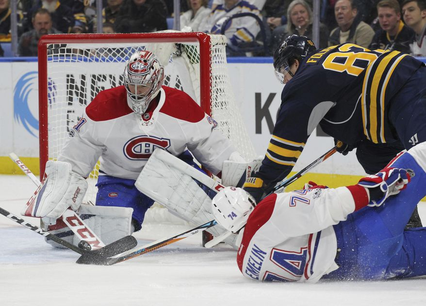 Buffalo Sabres forward Marcus Foligno (82) is stopped by Montreal Canadiens goalie Carey Price (31) during the first period of an NHL hockey game, Wednesday, April 5, 2017, in Buffalo, N.Y. (AP Photo/Jeffrey T. Barnes)