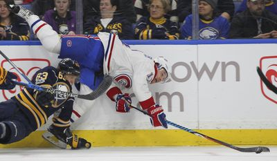 Buffalo Sabres forward Tyler Ennis (63) checks Montreal Canadiens forward Brendan Gallagher (11) during the second period of an NHL hockey game, Wednesday, April 5, 2017, in Buffalo, N.Y. (AP Photo/Jeffrey T. Barnes)
