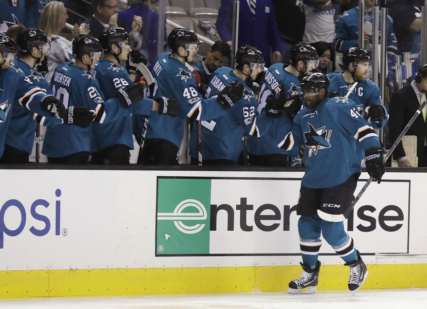 San Jose Sharks right wing Joel Ward, right, celebrates with teammates after scoring against the Vancouver Canucks during the first period of an NHL hockey game Tuesday, April 4, 2017, in San Jose, Calif. (AP Photo/Marcio Jose Sanchez)