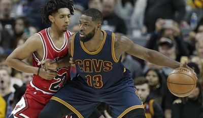 FILE - In this Feb. 25, 2017, file photo, Cleveland Cavaliers' Tristan Thompson, right, drives against Chicago Bulls' Cameron Payne in the first half of an NBA basketball game, in Cleveland. Cavaliers starting center Tristan Thompson sprained his right thumb and will miss Cleveland's first-place showdown with Boston on Wednesday night, April 5, 2017. Thompson got hurt during the third quarter of Tuesday's win over Orlando and did not travel with the team. (AP Photo/Tony Dejak, File)
