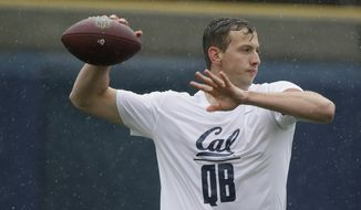 In this March 24, 2017 photo, California quarterback Davis Webb throws during NFL football pro day in Berkeley, Calif. Webb has the arm strength, confidence and leadership skills that NFL teams covet in quarterbacks. Webb heads into the draft with a bit of a stigma after spending three years running that spread offense at Texas Tech and then California as a graduate transfer. (AP Photo/Eric Risberg)