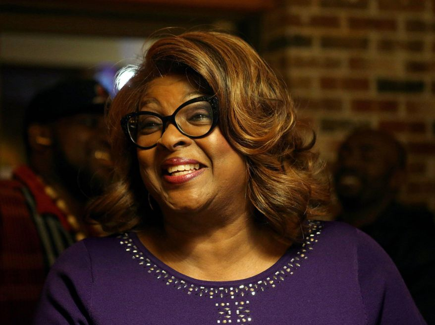 Ferguson mayoral candidate Ella Jones watches election results come in at Drake's Place in Ferguson, Mo., Tuesday, April 4, 2017. Two-term Mayor James Knowles III is opposed by Councilwoman Jones, who would become the first black mayor in Ferguson if elected. (David Carson/St. Louis Post-Dispatch via AP)
