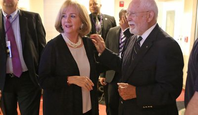 Newly elected mayor of St. Louis, Lyda Krewson, talks with former St. Louis Mayor James Conway at her victory party at the Norman K. Probstein Golf Course, Tuesday, April 4, 2017, in Forest Park near downtown St. Louis, Mo.  St. Louis' newly elected mayor is promising to help the city reduce the sort of violent crime that devastated her own family two decades ago. Democrat Krewson easily won over Republican Andrew Jones and four other candidates in the general election Tuesday.  (J.B. Forbes/St. Louis Post-Dispatch via AP)
