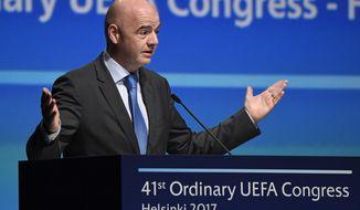 FIFA President Gianni Infantino speaks during the 41st Ordinary UEFA Congress Wednesday, April 5, 2017 at the Fair Centre Messukeskus, in Helsinki, Finland. (Markku Ulander/Lehtikuva via AP)