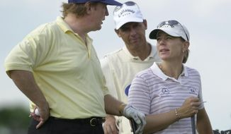 FILE - In this Nov. 20, 2002 file photo, Donald Trump talks with Annika Sorenstam of Stockholm, Sweden, right, during the LPGA Tour Championships ProAm round as they wait to tee off on the 15th tee at the Trump International Gulf Club in West Palm Beach, Fla. (AP Photo/Marta Lavandier, File)