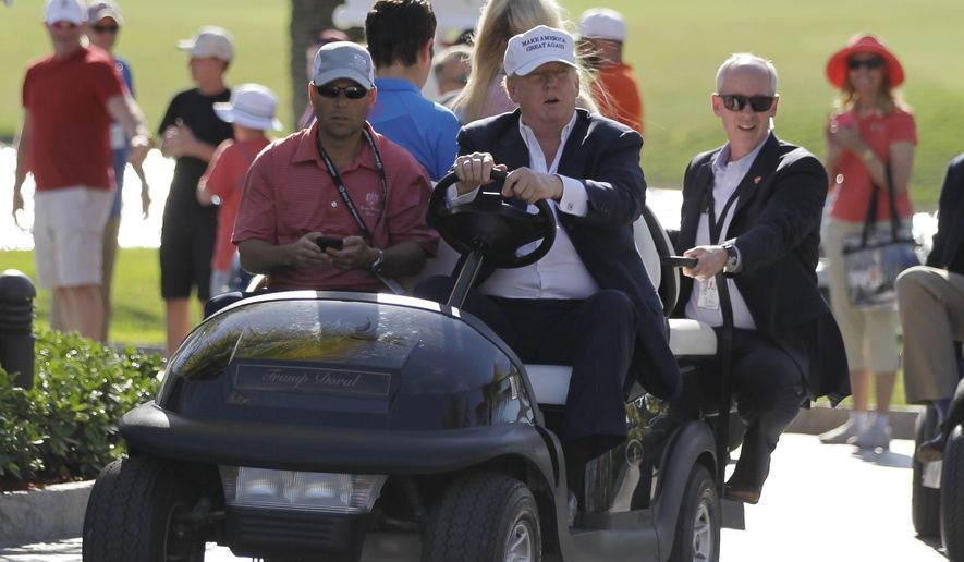 FILE- In this March 6, 2016 file photo, Donald Trump drives himself around the golf course to watch the final round of the Cadillac Championship golf tournament in Doral, Fla. Leave your ego in the clubhouse if you ever get the chance to golf with President Donald Trump. He may well throw shade on your game. And puff up his own. (AP Photo/Luis Alvarez, File)