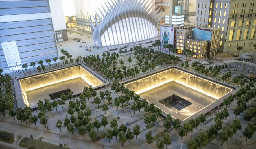 The National September 11 Memorial and the Oculus are depicted in the New York City section of the Gulliver's Gate exhibit, Wednesday, April 5, 2017, in New York. The indoor 49,000-square-foot diorama includes scale models of structures and landscapes from the Brooklyn Bridge and the Eiffel Tower to the pyramids of Egypt and China's Forbidden City, along with the Taj Mahal, Mecca, Niagara Falls and Rio de Janeiro's Christ the Redeemer statue. (AP Photo/Mary Altaffer)