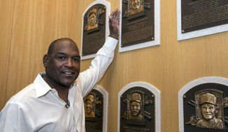 In this photo provided by the National Baseball Hall of Fame and Museum, Tim Raines touches Gary Carter's Hall of Fame Plaque during Raines' Orientation Visit to the National Baseball Hall of Fame in Cooperstown, N.Y., Wednesday, April 5, 2017. Raines will be inducted on July 30. (Milo Stewart Jr./National Baseball Hall of Fame and Museum via AP)