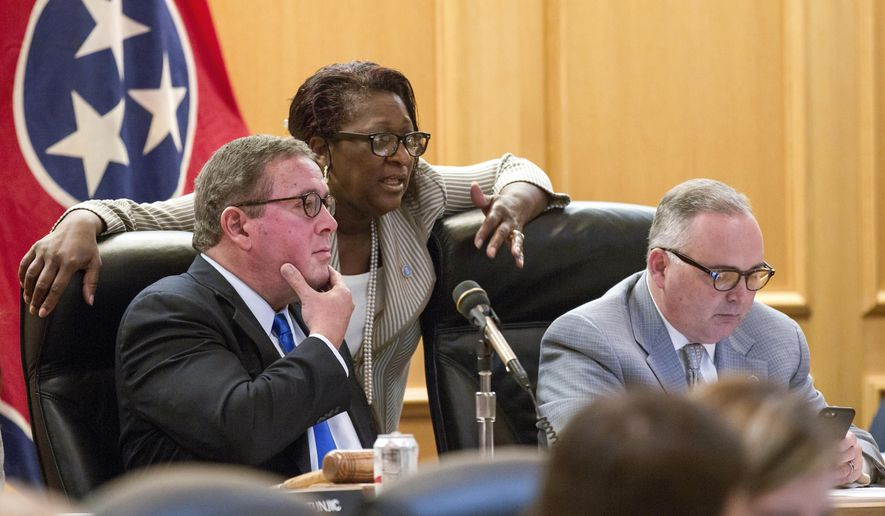 Rep. Gerald McCormick, R-Chattanooga, left, confers with Rep. Karen Camper, D-Memphis, before a House Finance Subcommittee in Nashville, Tenn., on Wednesday, April 5, 2017. Rep. Kevin Brooks, R-Cleveland is at right. The panel later voted to advance Republican Gov. Bill Haslam's road funding proposal that would include the state's first gas tax hike since 1989. (AP Photo/Erik Schelzig)