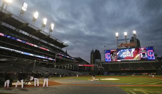 FILE - In this Oct. 23, 2016, file photo, the Cleveland Indians' take batting practice under the lights at Progressive Field in Cleveland, as they prepare to face the Chicago Cubs in baseball's World Series. The Indians announced Wednesday, April 5, 2017, that they changed the lights in those signature towers high above Progressive Field. The previous bulbs have been replaced by cost efficient LED lights, which will be brighter and cut down on electrical consumption.  (AP Photo/Aaron Josefczyk, File)