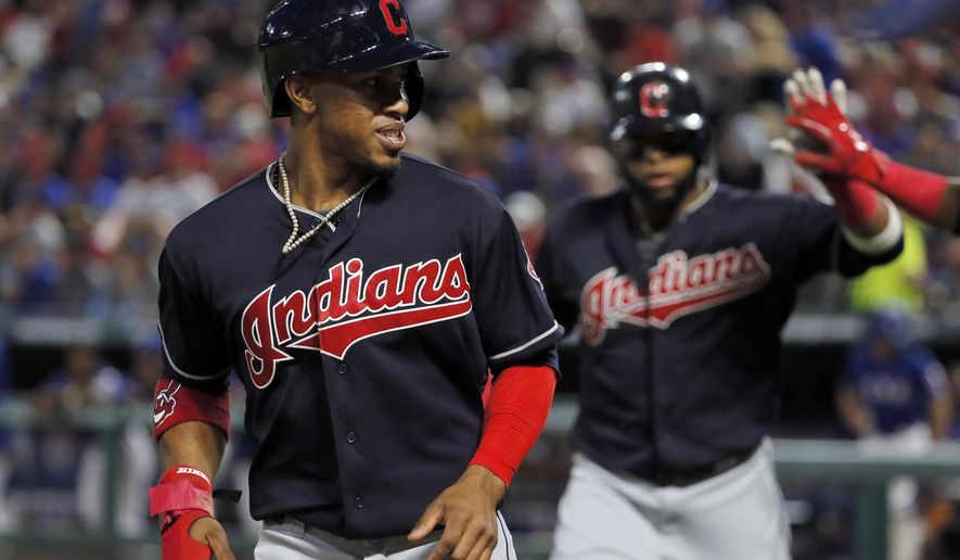 Cleveland Indians' Francisco Lindor, left, and Carlos Santana, right, jog to the dugout after scoring on a Jose Ramirez single in the fourth inning of a baseball game in Arlington, Texas, Wednesday, April 5, 2017. (AP Photo/Tony Gutierrez)
