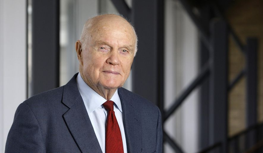 In this Jan. 25, 2012, file photo, former astronaut and Sen. John Glenn poses for a photo during an interview at his office in Columbus, Ohio. Glenn died on Dec. 8, 2016 at age 95. He will be interred Wednesday, April 5, 2017, in a small private ceremony at Arlington National Cemetery in Virginia. (AP Photo/Jay LaPrete, File)