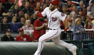 Washington Nationals right fielder Bryce Harper (34) sprints to home plate from third during the fourth inning of a baseball game against the Miami Marlins in Washington, Wednesday, April 5, 2017. (AP Photo/Manuel Balce Ceneta)